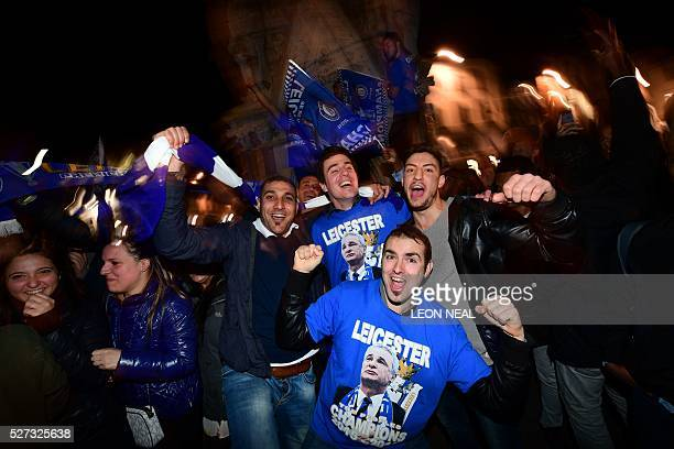 TOPSHOT Leicester City fans celebrate their team becoming the English Premier League champions in central Leicester eastern England on May 2 2016...