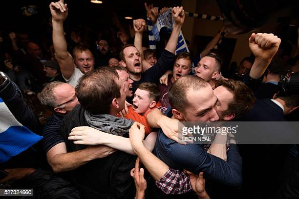 Leicester City fans celebrate winning the Premier League at the final whistle of the English Premier League football match between Chelsea and...