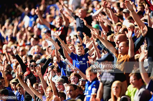 Leicester City fans cheer during the Barclays Premier League match between Leicester City and Arsenal at The King Power Stadium on August 31 2014 in...