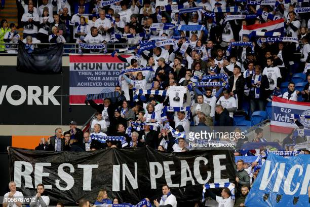 Leicester City fans commemorate Vichai Srivaddhanaprabha by holding up scarfs and signs during the Premier League match between Cardiff City and...