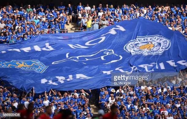 Leicester City fans display a large flag during the FA Community Shield football match between Manchester United and Leicester City at Wembley...