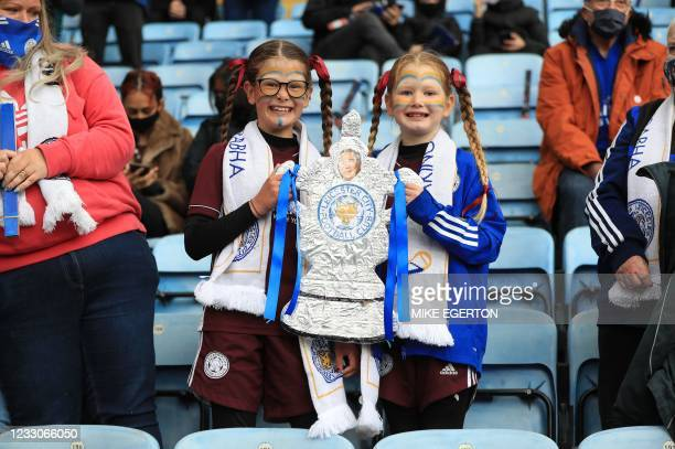 Leicester City fans hold a home made FA Cup ahead of the English Premier League football match between Leicester City and Tottenham Hotspur at King...