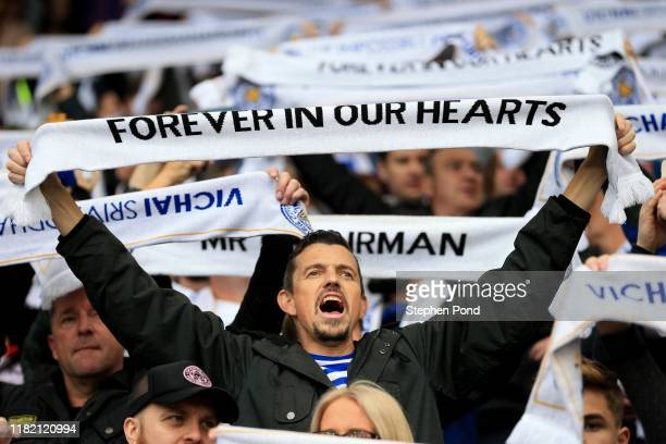 Leicester City fans hold scarves following a minutes silence for former Leicester City owner Vichai Srivaddhanaprabha prior the Premier League match...
