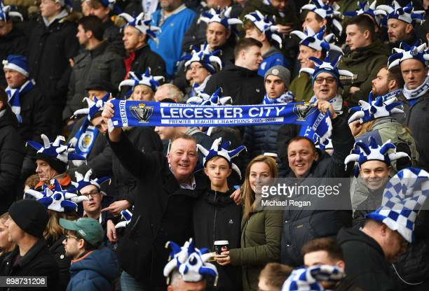 Leicester City fans pose prior to the Premier League match between Watford and Leicester City at Vicarage Road on December 26 2017 in Watford England