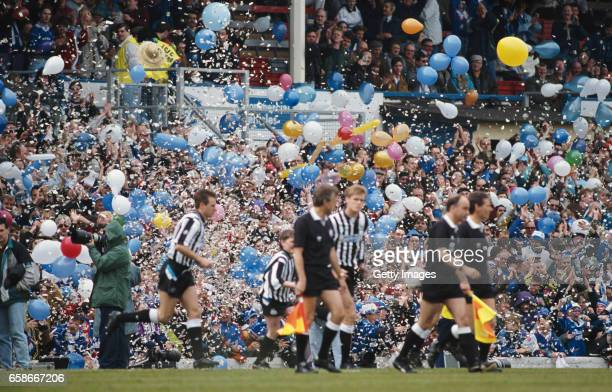 Leicester City fans provide a tickertape and balloon entrance for the teams before a League Divsion Two match against Newcastle United at Filbert...