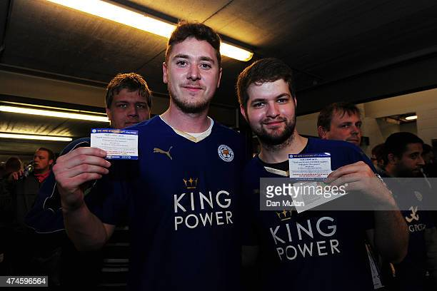 Leicester City fans show the ticket to exchange free beer prior to the Barclays Premier League match between Leicester City and Queens Park Rangers...