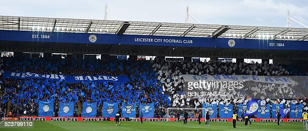 Leicester City fans wave banners and flags before kick off of the English Premier League football match between Leicester City and Swansea at King...