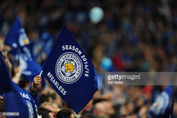 Leicester City fans wave flags prior to the Barclays Premier League match between Leicester City and Queens Park Rangers at The King Power Stadium on...