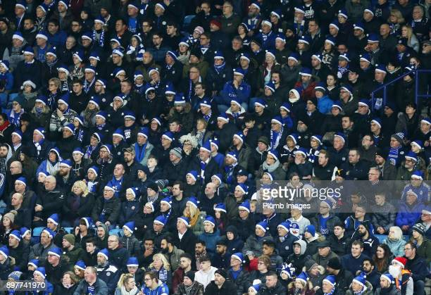 Leicester City fans wearing their complimentary blue Santa hats during the Premier League match between Leicester City and Manchester United at King...