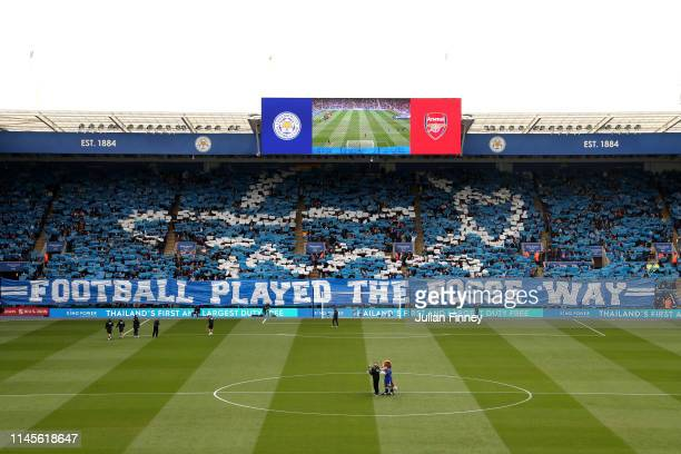 Leicester City fans welcome their team with a 'tifo' display prior to the Premier League match between Leicester City and Arsenal FC at The King...