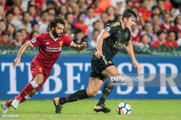Leicester City FC defender Harry Maguire battles for the ball with Liverpool FC forward Mohamed Salah during the Premier League Asia Trophy match...