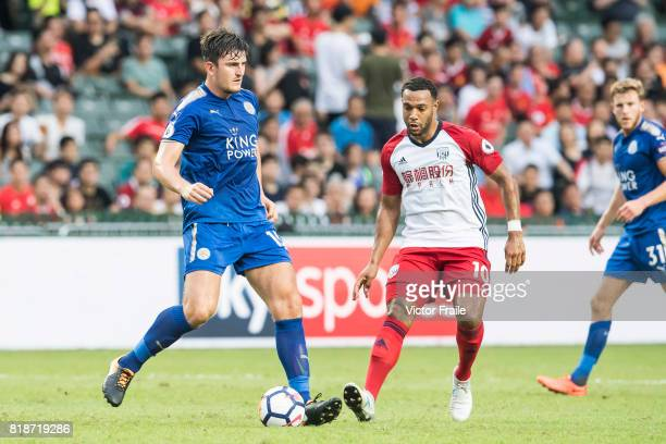Leicester City FC defender Harry Maguire competes for the ball with West Bromwich Albion midfielder Matt Phillips during the Premier League Asia...