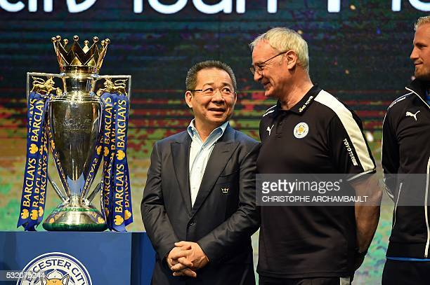 Leicester City FC's Italian manager Claudio Ranieri chats with the club owner Vichai Srivaddhanaprabha as they take part in a presentation of the...