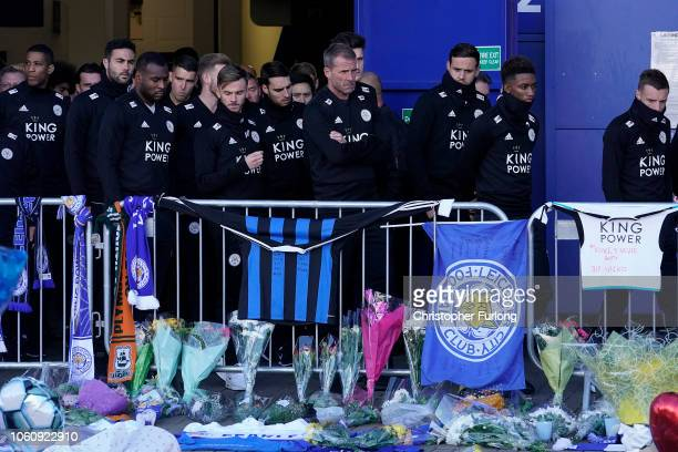 Leicester City Football Club players pay their respects at the sea of tributes to the victims of the helicopter crash at Leicester City Football...