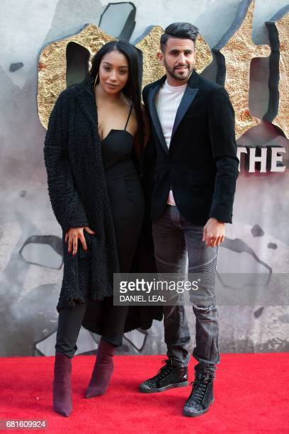 Leicester City footballer Riyad Mahrez and his wife Rita pose for a photograph upon arrival at the European Premiere of King Arthur legend of the...