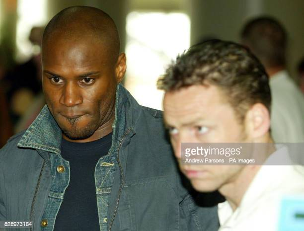 Leicester City footballers from left Frank Sinclair and Paul Dickov checkin for a flight back to the UK at Alicante aiport They have been accused of...