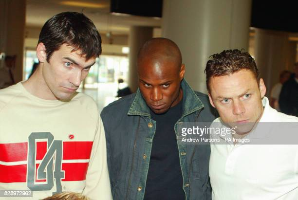 Leicester City footballers from left Keith Gillespie Frank Sinclair and Paul Dickov checkin for a flight back to the UK at Alicante aiport They have...