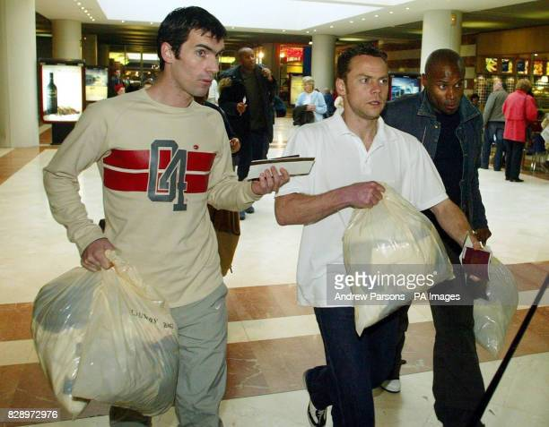 Leicester City footballers from left Keith Gillespie Paul Dickov and Frank Sinclair walk through Alicante airport for a flight back to the UK They...