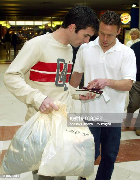 Leicester City footballers Keith Gillespie and Paul Dickov check their tickets at Alicante airport before a flight back to the UK They have been...
