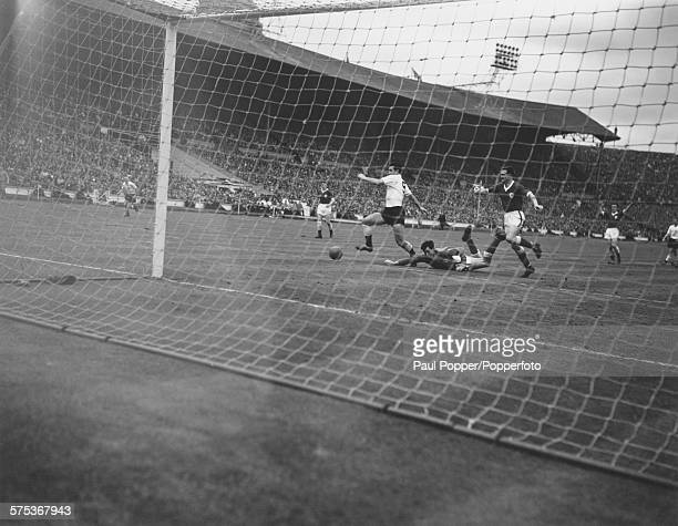Leicester City goalkeeper Gordon Banks on the ground during an attack on the Leicester goal by Tottenham Hotspur centreforward Bobby Smith during the...