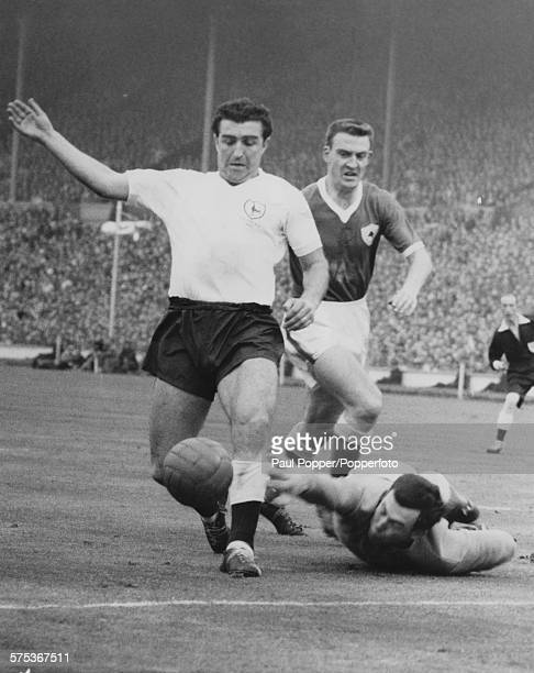 Leicester City goalkeeper Gordon Banks successfully taps the ball from the feet of Tottenham Hotspur centreforward Bobby Smith during an attack on...