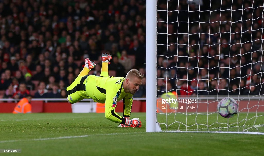 Leicester City goalkeeper Kasper Schmeichel is unable to save the shot from Nacho Monreal of Arsenal who scores a goal to make it 1-0 during the Premier League match between Arsenal and Leicester City at Emirates Stadium on April 26, 2017 in London, England.