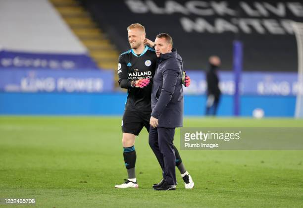 Leicester City Manager Brendan Rodgers and Kasper Schmeichel of Leicester City celebrate after the Premier League match between Leicester City and...