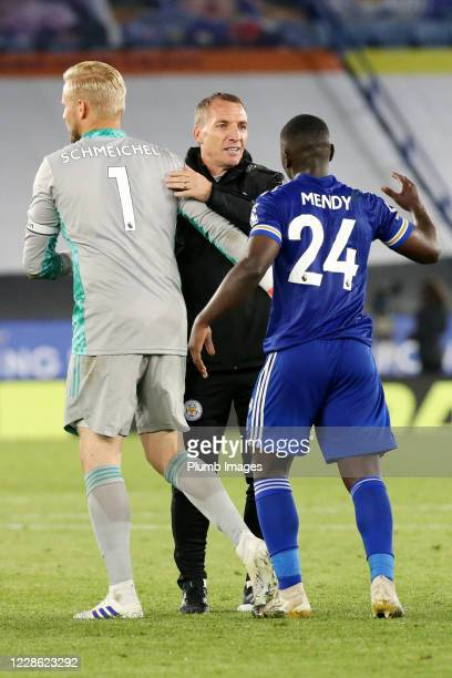 Leicester City Manager Brendan Rodgers Kasper Schmeichel of Leicester City and Nampalys Mendy of Leicester City celebrate after the Premier League...