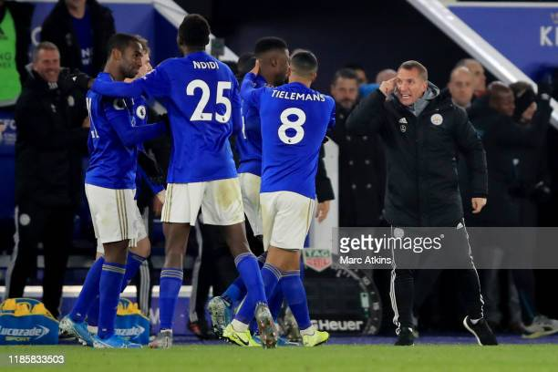 Leicester City manager Brendan Rodgers speaks to his players after the winning goal is scored during the Premier League match between Leicester City...