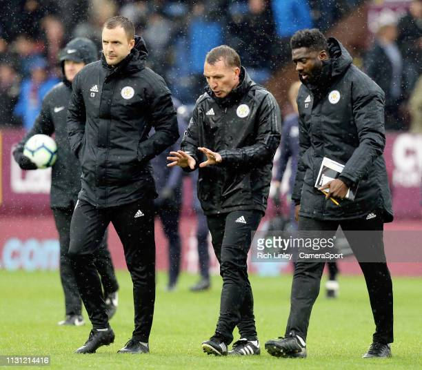 Leicester City manager Brendan Rogers talks to his coaching staff as he makes his way to the dressing room at half time during the Premier League...