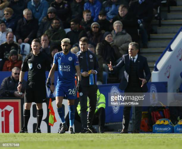 Leicester City manager Claude Puel speaks to Riyad Mahrez of Leicester during the Premier League match between Leicester City and Stoke City at The...