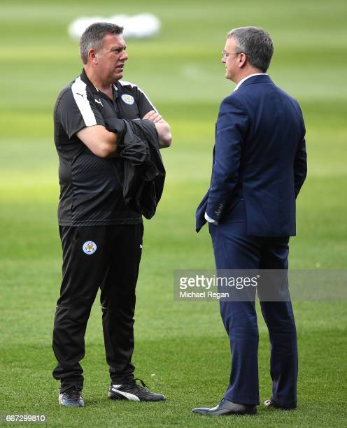 Leicester City Manager Craig Shakespeare speaks with Director of Foorball John Rudkin during a Leicester City training session ahead of their UEFA...