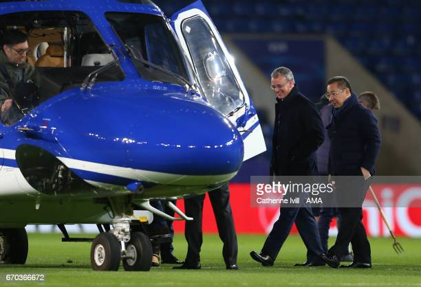 Leicester City owner Vichai Srivaddhanaprabha heads to his helicopter with Director of football Jon Rudkin during the UEFA Champions League Quarter...