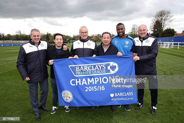 Leicester City owner Vichai Srivaddhanaprabha his son Aiyawatt Leicester City manager Claudio Ranieri and Wes Morgan celebrate winning the Premier...