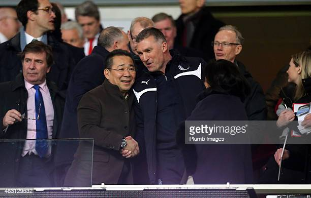 Leicester City owner Vichai Srivaddhanaprabha shakes hands with manager Nigel Pearson during the Barclays Premier League match between Arsenal and...
