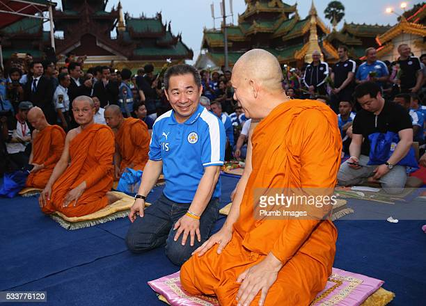 Leicester City owner Vichai Srivaddhanaprabha talks to a Buddhist monk as Premier League champions Leicester City visit Shwedagon Pagoda during their...