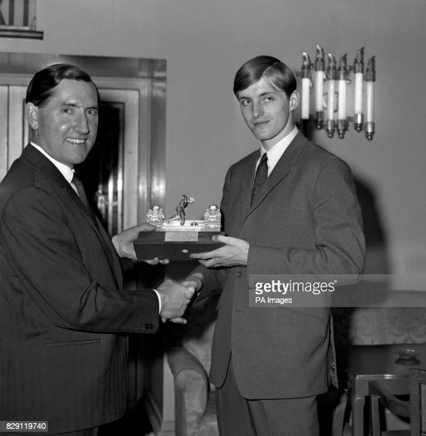 Leicester City player Allan Clarke is presented with the Man of the Match trophy by Leicester manager Frank O'Farrell at the club's banquet at the...