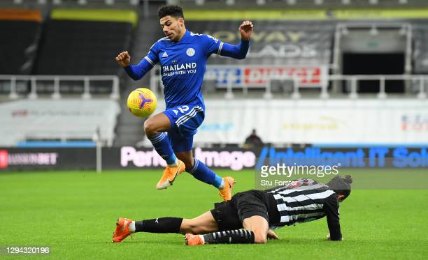 Leicester City player James Justin skips the challenge of Fabian Schar of Newcastle during the Premier League match between Newcastle United and...