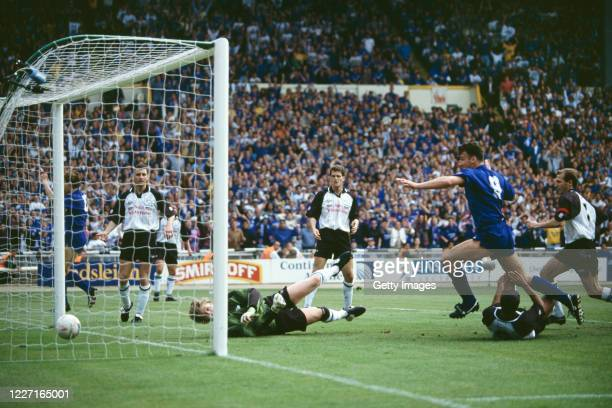 Leicester City player Steve Walsh scores the winning goal past Derby goalkeeper Martin Taylor as Craig Short and captain Gordon Cowans of Derby look...