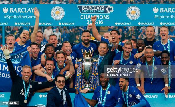 Leicester City players and Leicester City's Thai chairman Vichai Srivaddhanaprabha pose with the Premier league trophy after winning the league and...