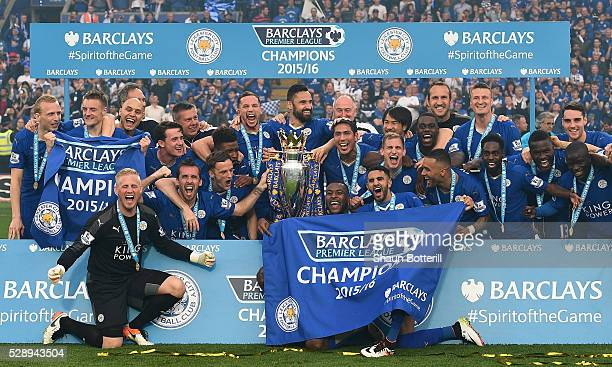 Leicester City players and staffs celebrate the season champions with the Premier League Trophy after the Barclays Premier League match between...