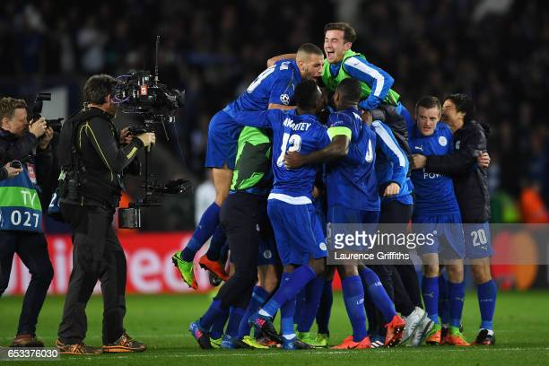 Leicester City players celebrate as the final whistle blows during the UEFA Champions League Round of 16 second leg match between Leicester City and...