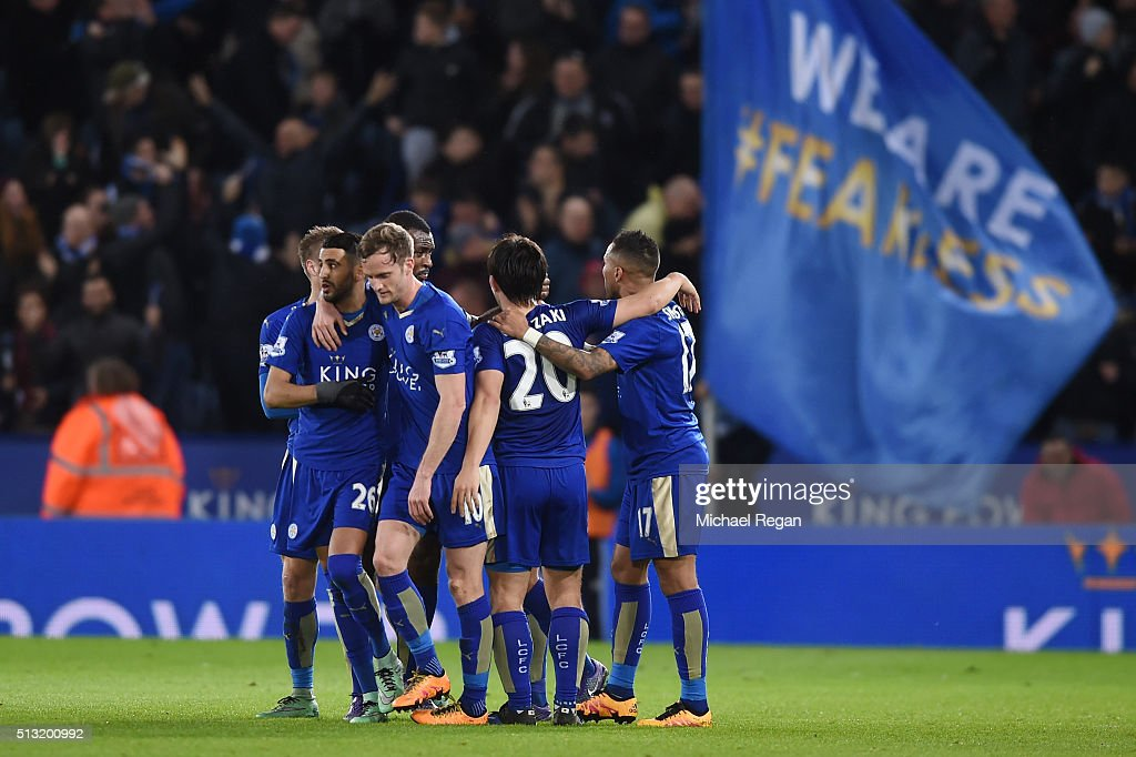 Leicester City players celebrate their team's first goal by Danny Drinkwater (obscured) during the Barclays Premier League match between Leicester City and West Bromwich Albion at The King Power Stadium on March 1, 2016 in Leicester, England.
