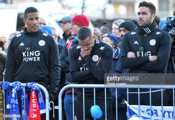 Leicester City players Danny Simpson and Vicente Iborra pay their respects at the sea of tributes to the victims of the crash at Leicester City...