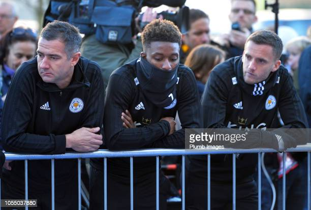 Leicester City players Demarai Gray and Andy King pay their respects at the sea of tributes to the victims of the crash at Leicester City Football...