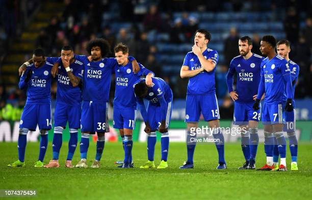 Leicester City players look dejected as they look on in the penalty shoot out during the Carabao Cup Quarter Final match between Leicester City and...