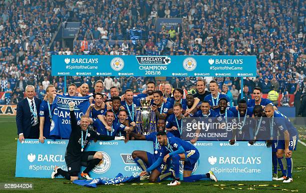 Leicester City players pose with the Premier league trophy after winning the league and the English Premier League football match between Leicester...