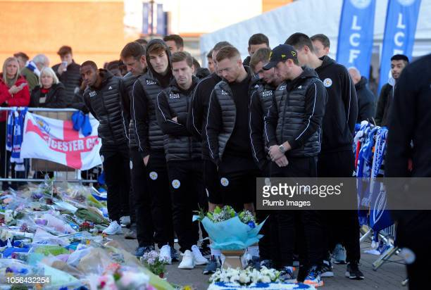 Leicester City Players Ricardo Pereira Calgar Soyuncu Adrien Silva James Maddison and Ben Chilwell pay their respects following the death of club...
