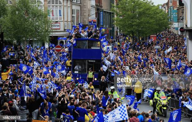 Leicester City players ride in an open top bus through the city centre during a victory parade in honour of the football club winning the SkyBet...