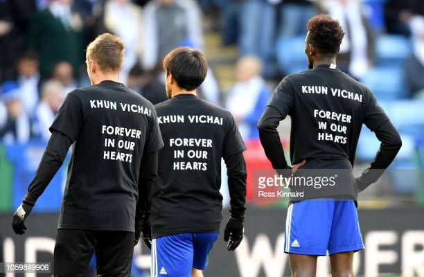 Leicester City players warm up whilst wearing shirts in tribute to Leicester City chairman Vichai Srivaddhanaprabha prior to the Premier League match...